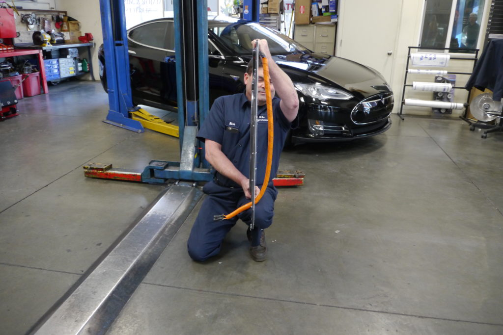 Rick shows off the ultra thin receiving coil that will allow his Tesla to receive wireless charging.
